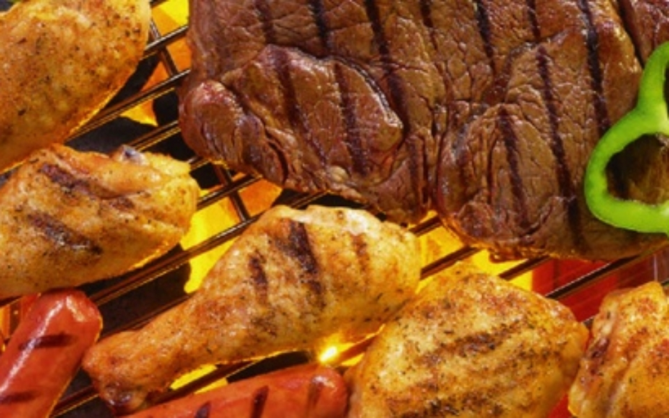 Variety of meat on a grill.